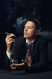 The man with a cigar and a glass of cognac Stock Photography