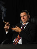 The man with a cigar and a glass of cognac Royalty Free Stock Photography
