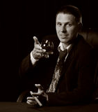The man with a cigar and a glass of cognac Stock Photo