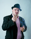 Man with cigar in hat Royalty Free Stock Photography