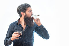 Man with cigar and whiskey Royalty Free Stock Photos