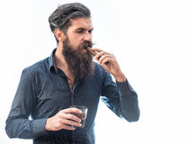 Man with cigar and whiskey Royalty Free Stock Images