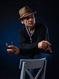Man with cigar and whiskey Stock Images