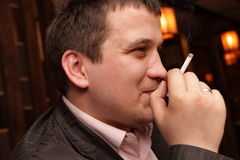 Man with cigarette Royalty Free Stock Image