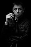 Man with cigarette. And scar on his face Royalty Free Stock Images