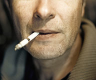 Man with a cigarette Royalty Free Stock Photo