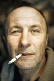 Man with a cigarette Stock Images