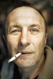 Man with a cigarette. Close-up portrait Stock Images