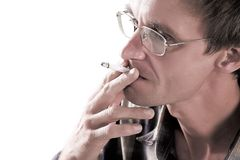 Man with cigarette. The man in points with a cigarette royalty free stock photos