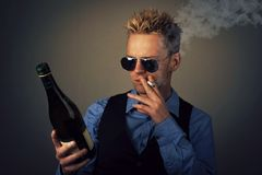 Man with cigarette and alcohol Royalty Free Stock Image