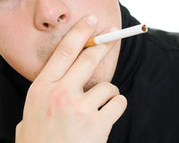 A man with a cigarette in his mouth. Royalty Free Stock Photography