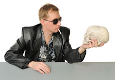 Man with a cigarette and a skull Stock Photo