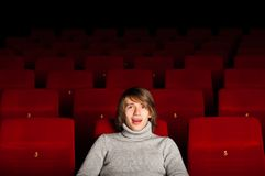 Man in the cinema. Young man in casual sitting in the cinema and watching a movie Stock Images