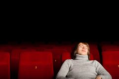 Man in the cinema. Young man in casual sitting in the cinema and watching a movie Stock Photography