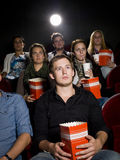 Man at the cinema with popcorn Royalty Free Stock Image