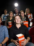 Man at the cinema with popcorn Royalty Free Stock Photos