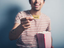 Man with cinema ticket and popcorn Stock Image
