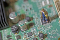 Man on Circuit Board Royalty Free Stock Photography