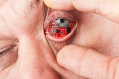 Man with a circuit board in his eye Stock Images