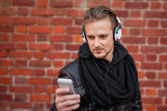 Man in the city listening to music on his headphones. Man listening to music on his headphones Royalty Free Stock Photo