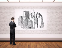 Man with city sketch Stock Photos