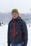 Man in a city  snow park Royalty Free Stock Photography