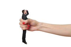 Man clamped in big female fist Stock Photo