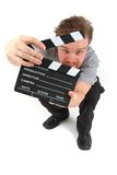 Man and clapboard Royalty Free Stock Images