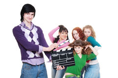 Man with clapboard over women Royalty Free Stock Image