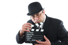 Man with clapper board Stock Photos