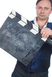 Man with clapperboard Royalty Free Stock Image
