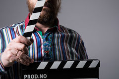 Man with clapperboard cinema Stock Photos