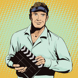 Man with clapperboard. People in retro style. Stock Photography