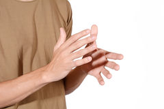 Man clapping his hands. Close-up of man clapping his hands. Isolated white background Stock Photo