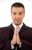 Man with clasped hands. Against white background Royalty Free Stock Photography