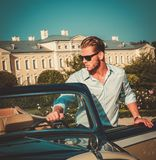 Man and classic convertible steering wheel Stock Image