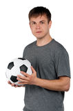 Man with classic soccer ball Stock Images