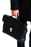 A man in a classic suit holds a black briefcase Stock Photo