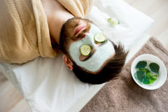 Man with a clay mask stock photography