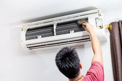 Man clean brush open hood air conditioner fin coil stock photos