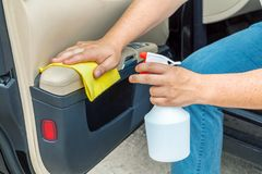 Man clean car door with fibre. In summer day royalty free stock photos