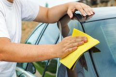 Man clean car with fibre. In summer day royalty free stock photography