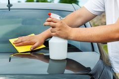 Man clean car. In summer day royalty free stock photo