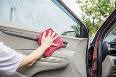 Man clean and wax the car. Outdoor car maintenance service concept stock images