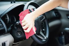 Man clean and wax the car. Outdoor car maintenance service concept stock photography