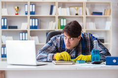The man cleaner stealing confidential documents Stock Photo