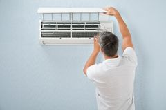 Man cleaning air conditioning system Royalty Free Stock Photo