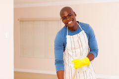 Man cleaning apartment Stock Photography
