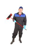 Man with cleaning broom. Isolated on a white background Stock Image