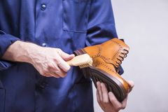 Man with Cleaning Brush For Premium Boots Royalty Free Stock Photo